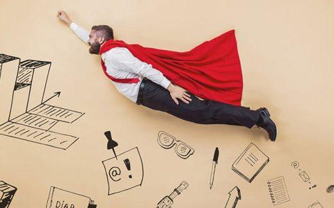 """Selbstüberschätzung ... ein Karriere-Stolperstein? / auf dem Foto: """"Fliegender"""" Angestellter als eine Art Superman."""