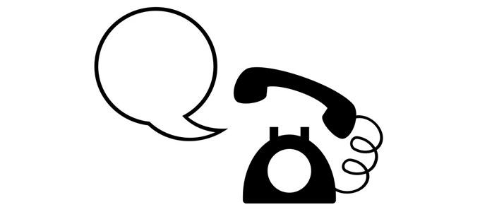 Man sieht ein analoges Telefon mit einer Sprechblase