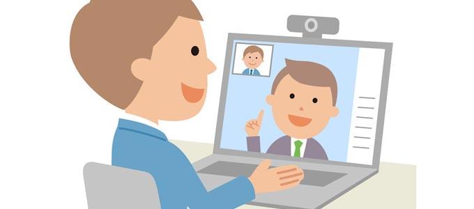 Man sieht zwei Männer in Cartoon style gezeichnet, wie sie eine Videokonferenz haben