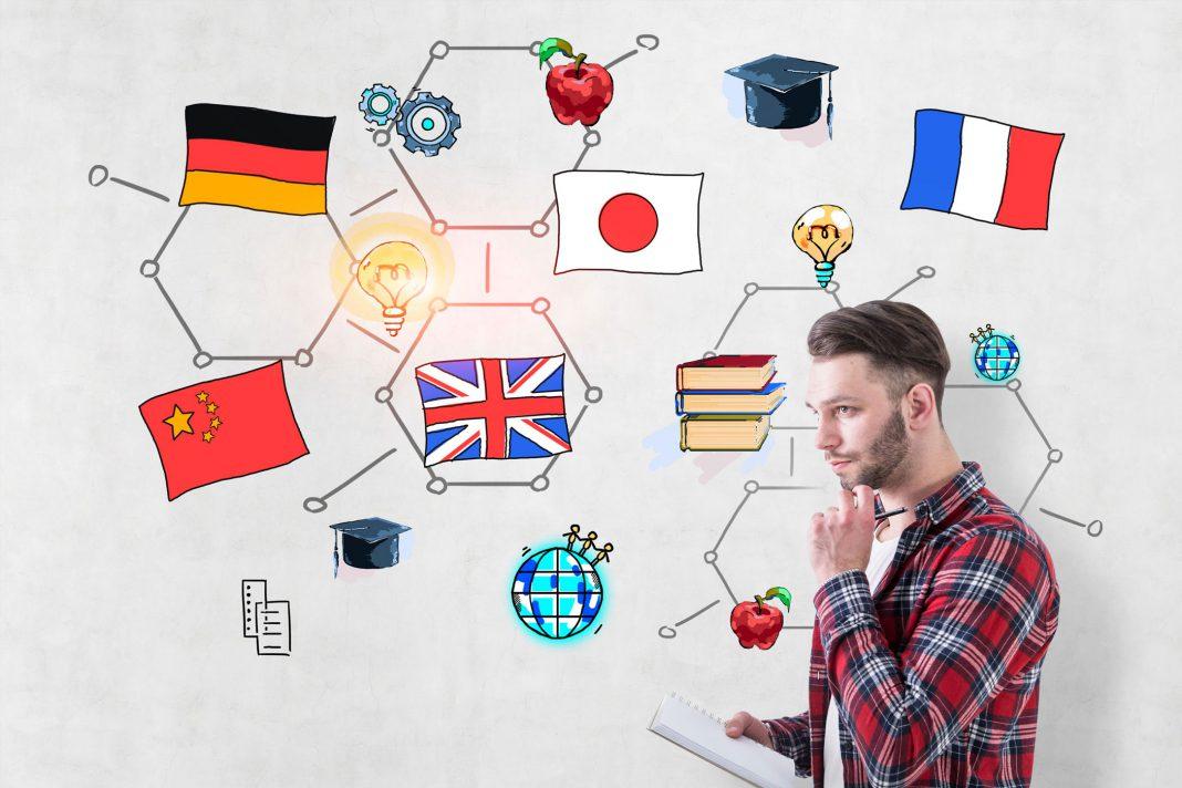 Ein Mann grübelt darüber was er lernen soll , man sieht Flaggen und anderen Themen